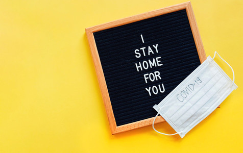 Flat lay of notice board with slogan message I stay home for you