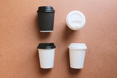 Paper coffee cups take away mock up on wooden background for bus