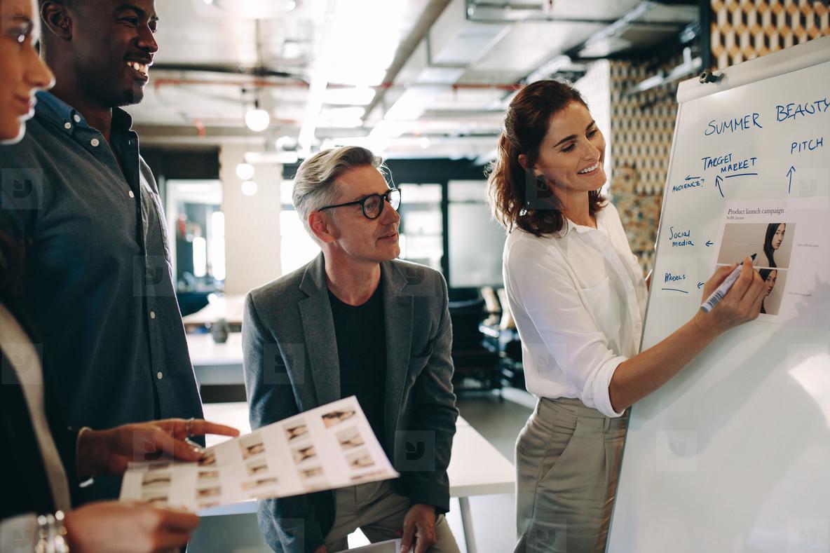 Female explaining new marketing strategy to team