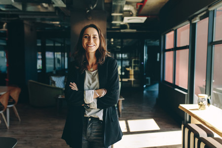 Successful businesswoman standing in office
