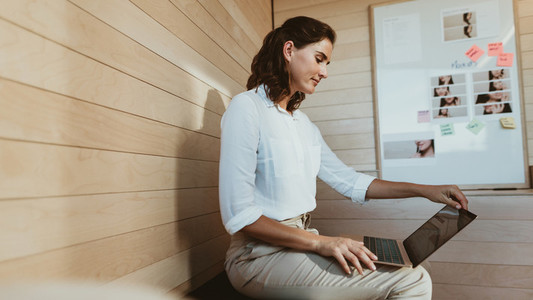 Businesswoman busy working on laptop
