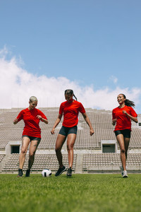 Female football team training in the field