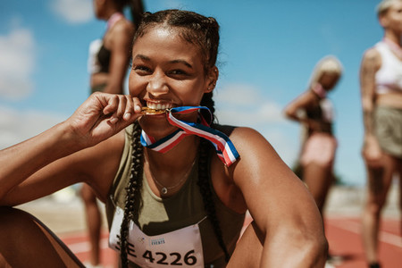 Runner looking excited after winning a medal