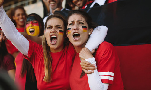 Females from Germany cheering from fan zone