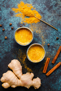 Top view of turmeric latte which is made from curcuma  ginger  cinnamon and allspice  Immune and healthcare drink