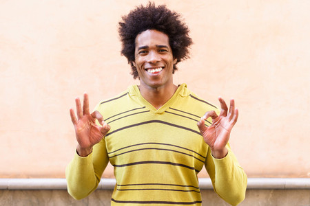 Black man with afro hair putting a funny expression