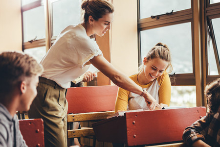 Teacher assisting a student in the classroom