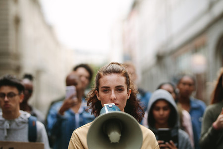 People on strike protesting with megaphone