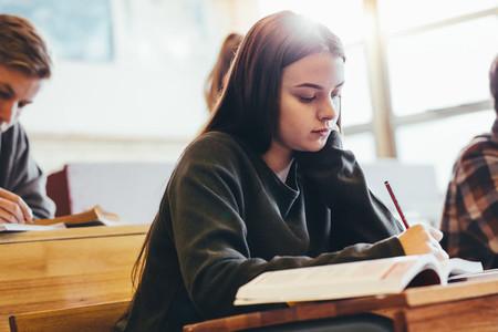 Female student in high school classroom