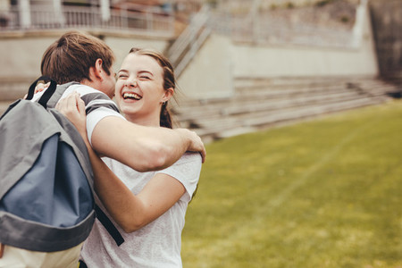 High school students smiling and embracing each other