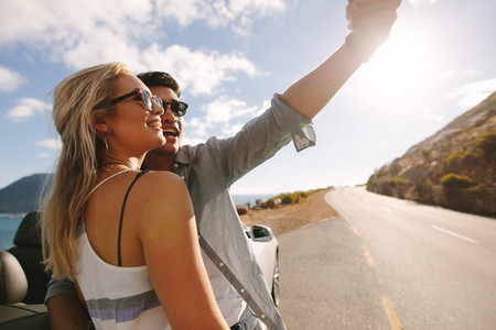 Couple capturing memories on their road trip