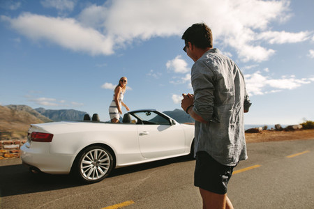 Couple having a photo shoot on their road trip