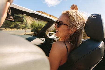 Woman with her boyfriend enjoying on a roadtrip