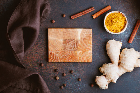 Ingredients for preparation turmeric latte creative composition Curcuma ginger cinnamon and allspice