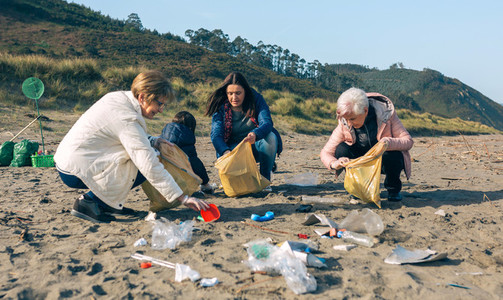 Female volunteers cleaning the beach