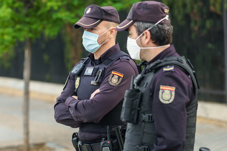 Spanish police with protective masks due to Coronavirus