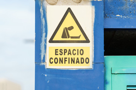 Sign with the text confined space due to the Covid 19 pandemic