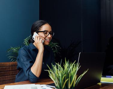 Smiling woman sitting at desk