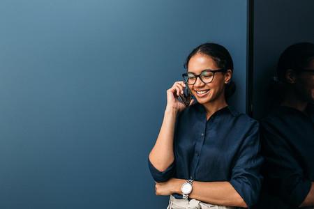 Smiling woman making phone call