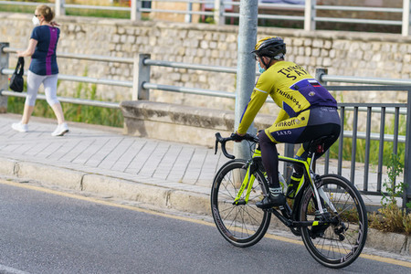 Man riding bike  wearing mask  as protection from the Covid 19 pandemic