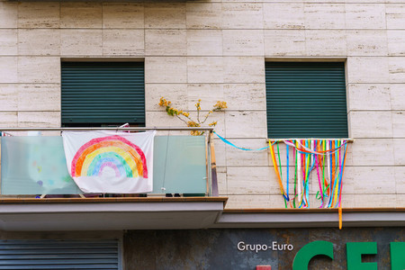 Rainbow drawing in the facade symbol of hope during Covid 19 outbreak