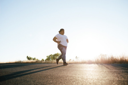 Plus size woman running in morning