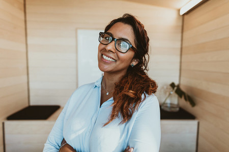 Smiling businesswoman with eyeglasses in office