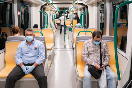 People wearing surgical mask in the train during the Covid 19 pandemic
