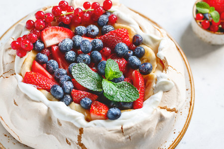 New Zealand Pavlova cake with whipped cream and mix of fresh berries