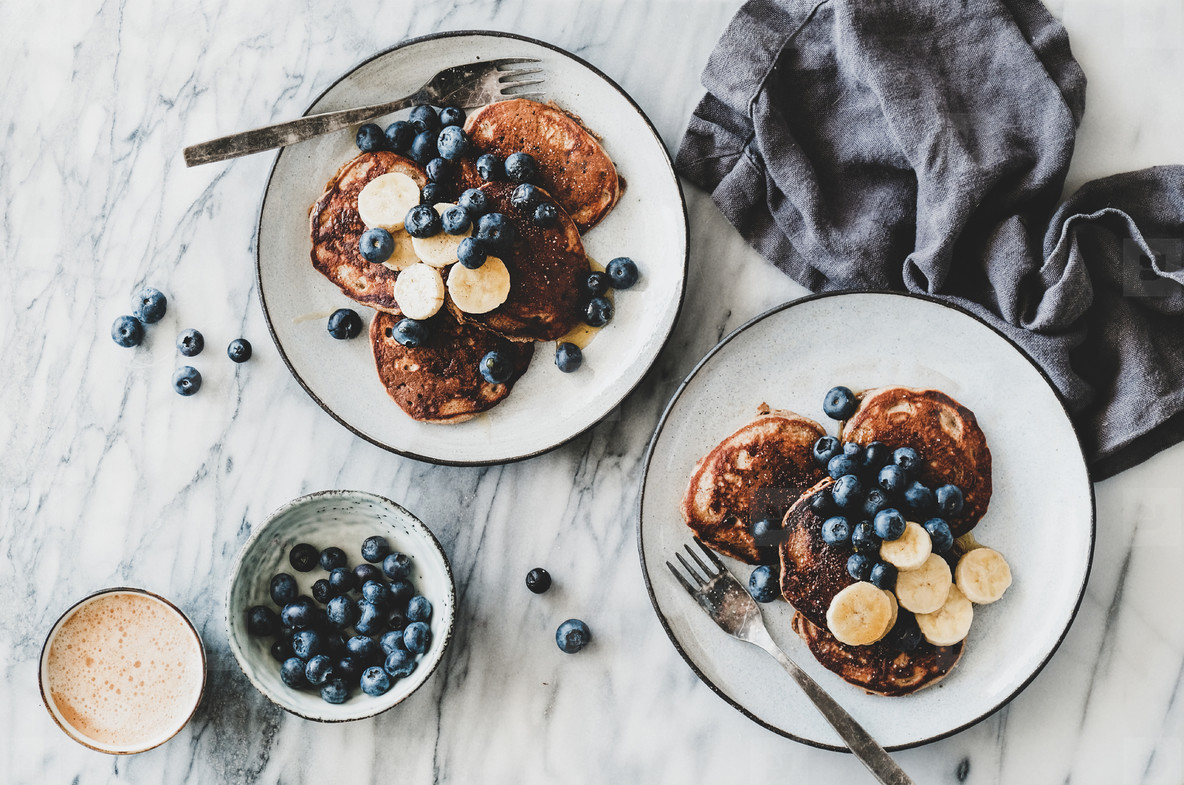Breakfast banana pancakes with blueberry  honey and coffee