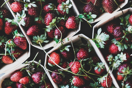 Food texture  background  wallpaper with fresh garden strawberries in boxes