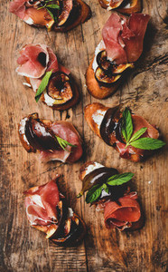 Crostini with prosciutto  goat cheese and grilled figs on board