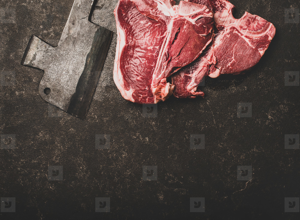 Flat lay of fresh uncooked beef meat t bone steaks  copy space