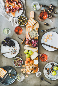 Mid summer seasonal picnic with rose wine  cheese  charcuterie and fruits