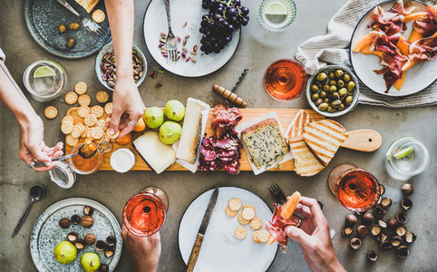 Mid summer picnic with rose wine  cheese  charcuterie and appetizers