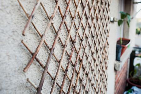 Wooden latticework on a wall of a balcony