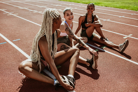 Athletes doing stretching exercises on the running track
