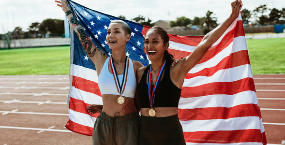 American athletes celebrating a sports event victory