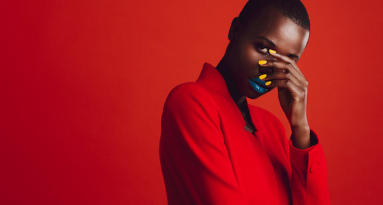 Glamorous female model on red background