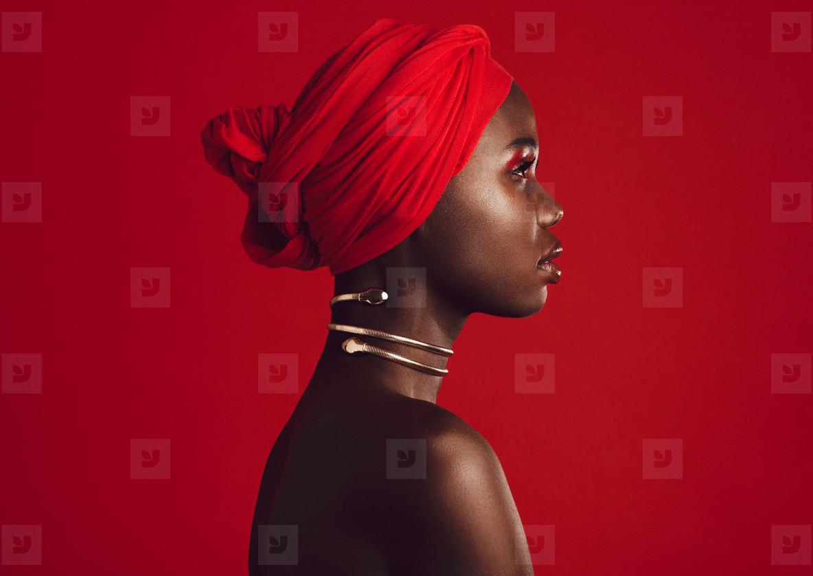 Stylish woman wearing red turban
