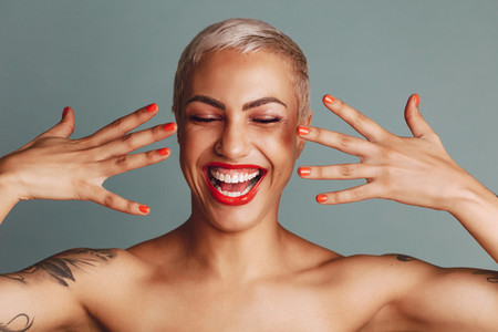 Excited female model showing her makeup