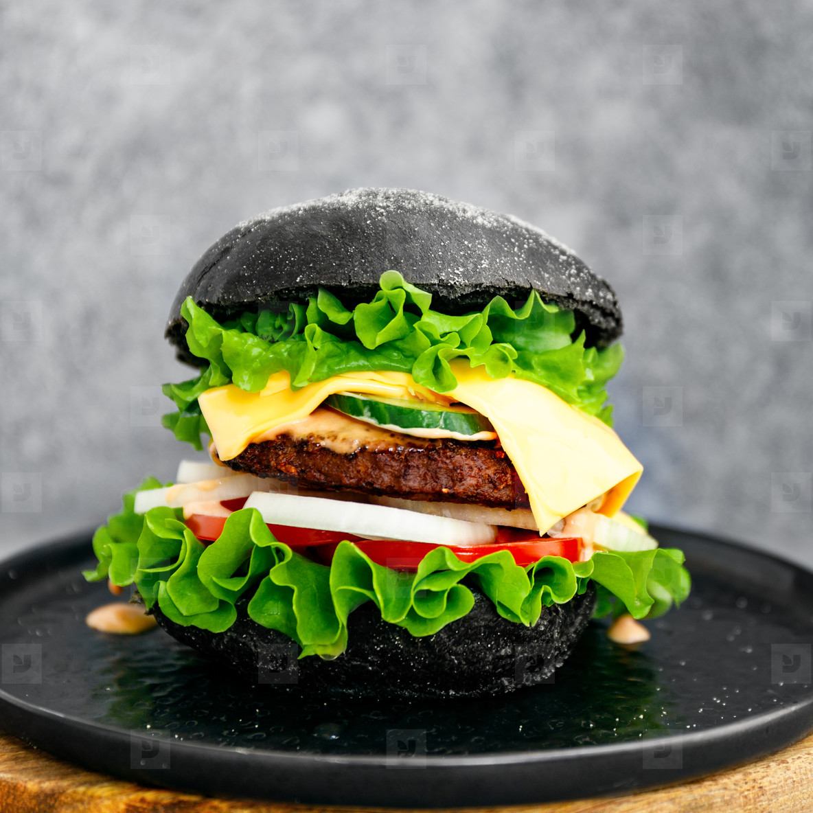 Big black burger with marble beef patty  cheese and fresh vegetables