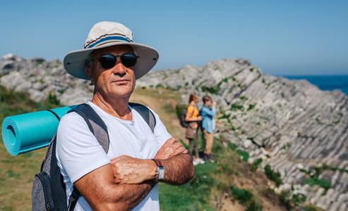 Senior man trekking looking at camera