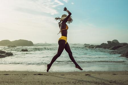 Woman enjoying herself at the beach