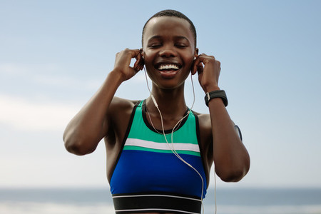 Runner listening music to get relax after workout