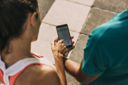 Runners using a fitness app to monitor their performance
