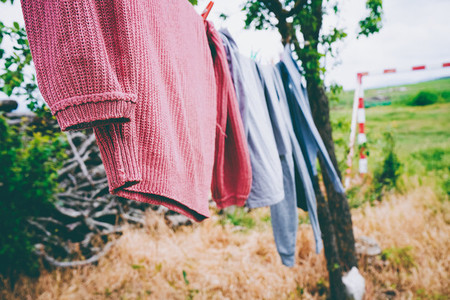 hanging out the clothes outdoors