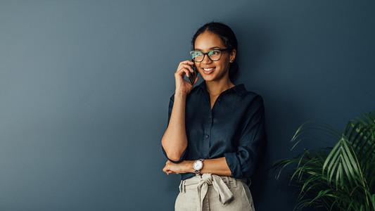 Smiling entrepreneur leaning