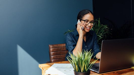 Entrepreneur sitting at table