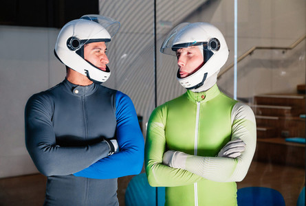 Two smiling flying men are prepared to fly in the wind tunnel